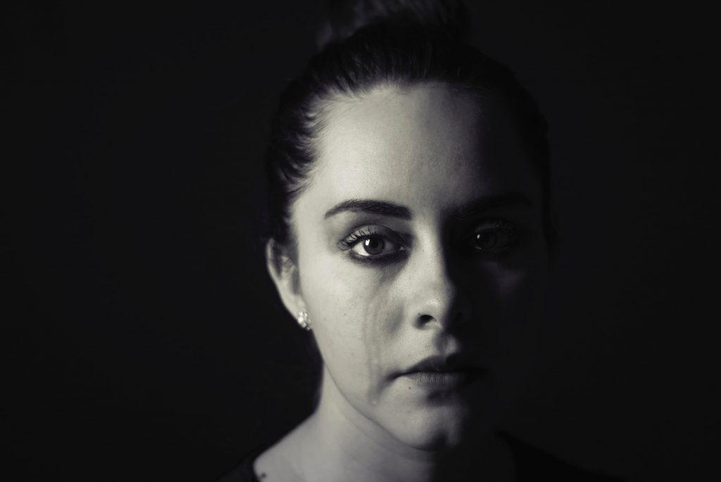 szomorú női arc